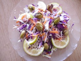 poured the mixed cabbage and carrot salad in a plate